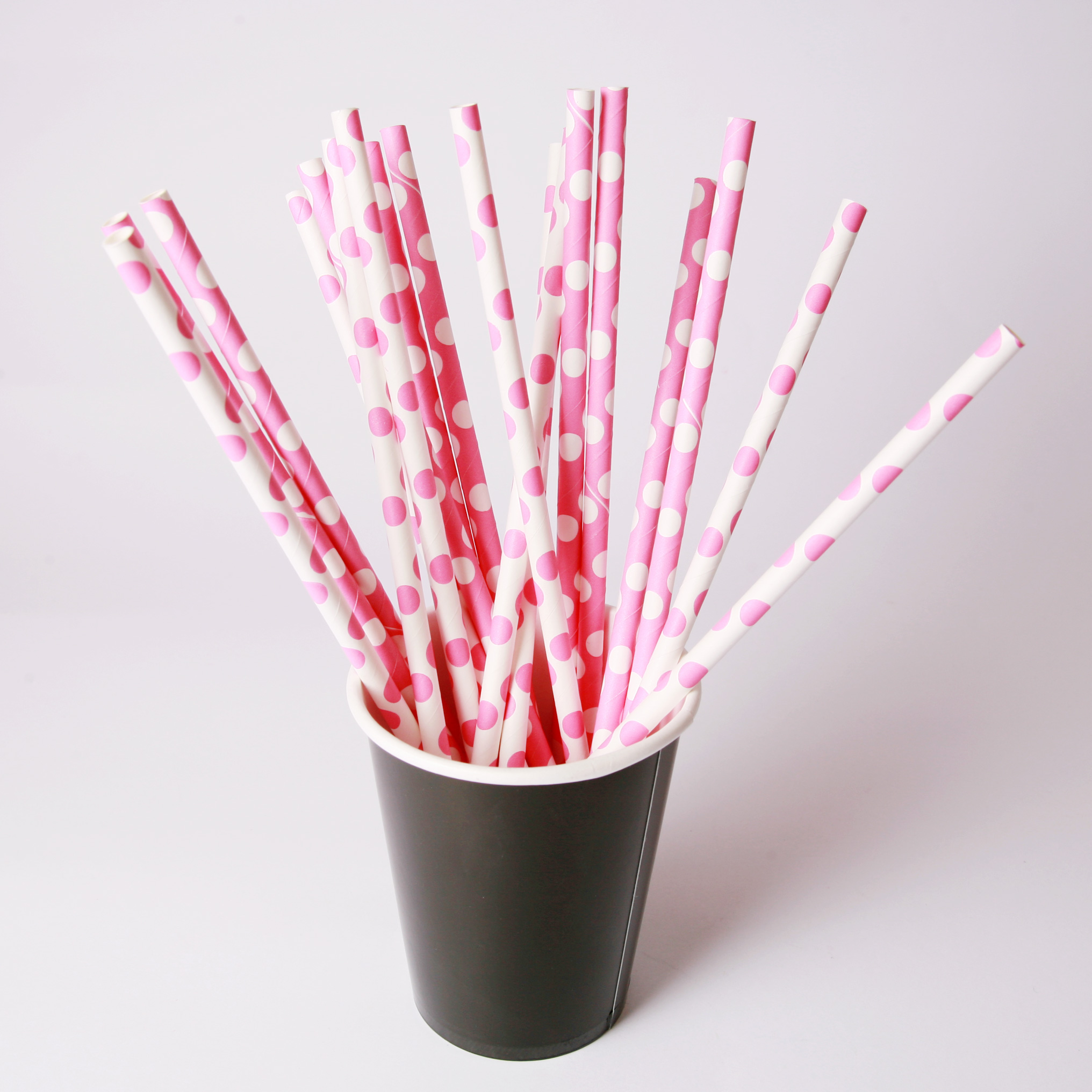 pink and white paper straws
