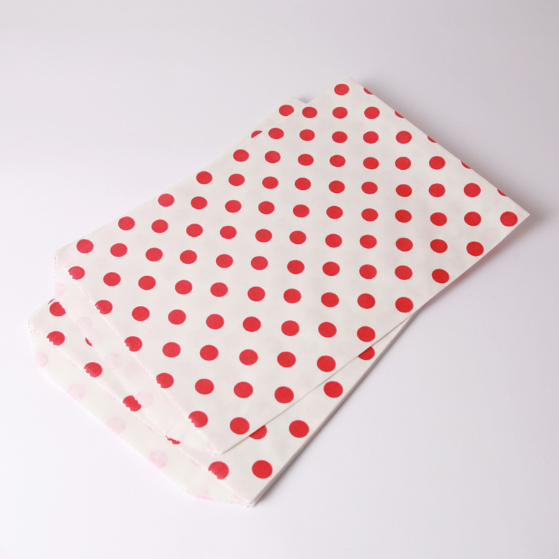 8 red polka dot paper party bags