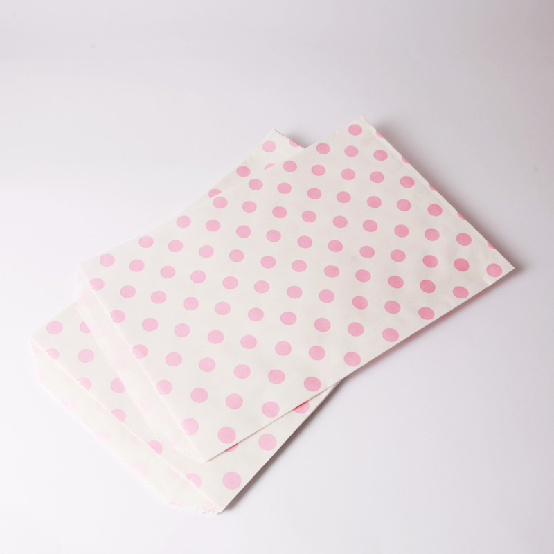 8 pink polka dot paper party bags