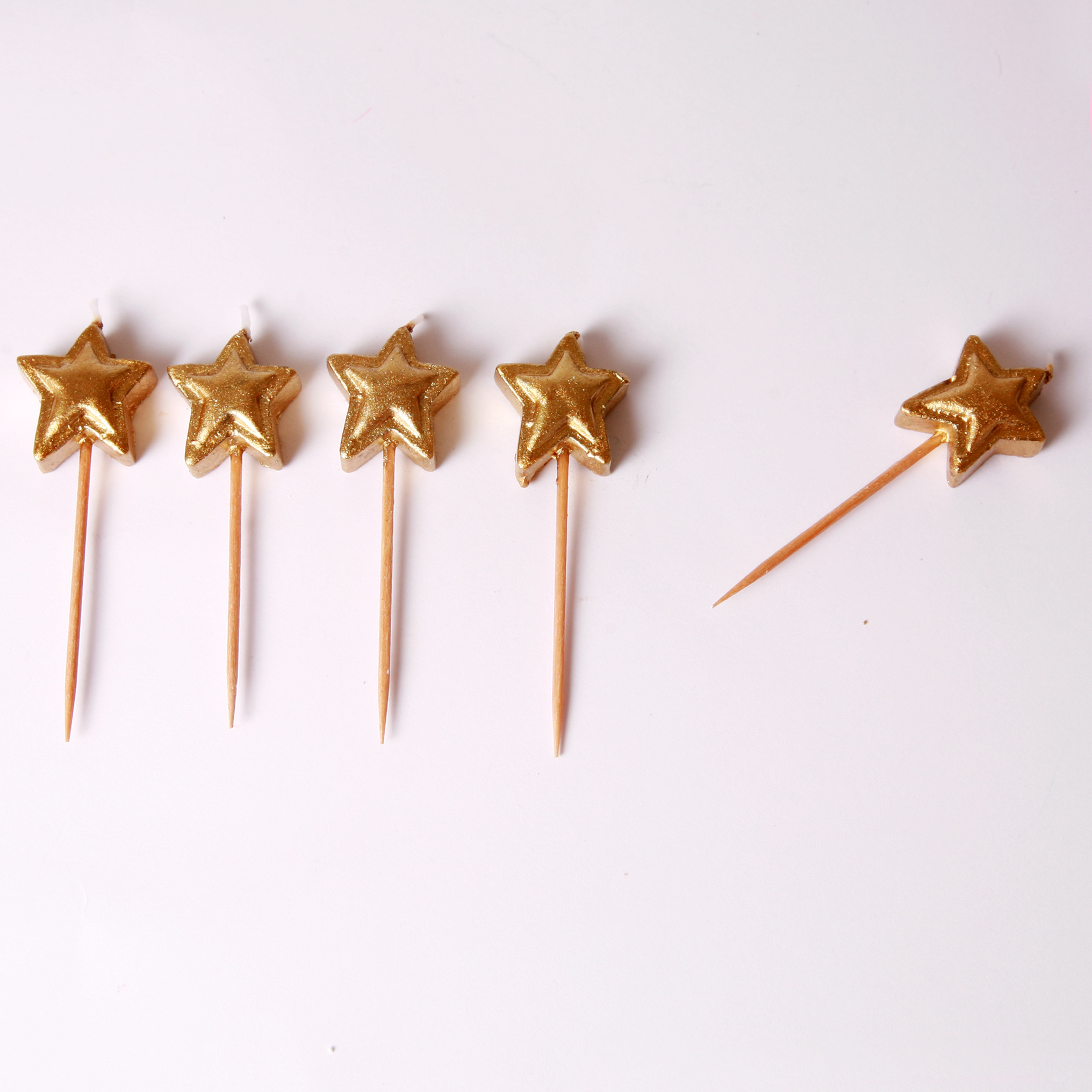 5 Gold star candles