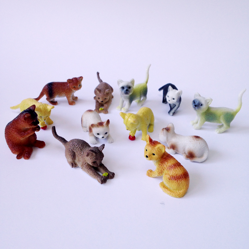 set of 12 toy cats